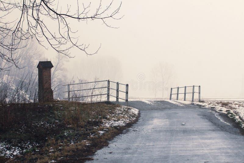Road and bridge in snow landscape stock photo