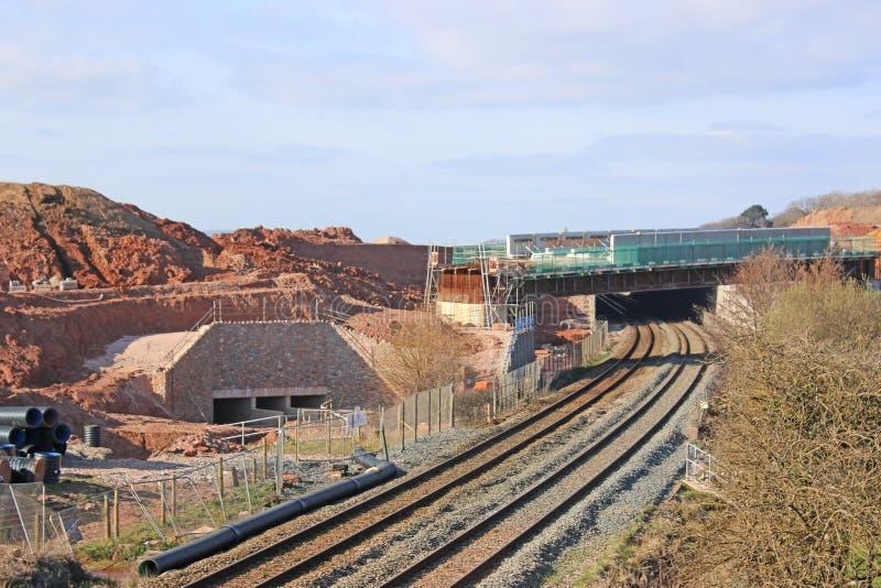 Road bridge under construction over a railway stock images