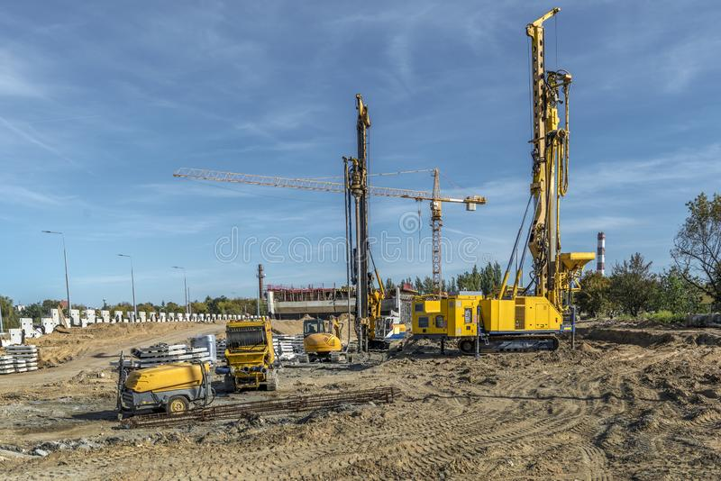 Road building with drilling machines royalty free stock photos