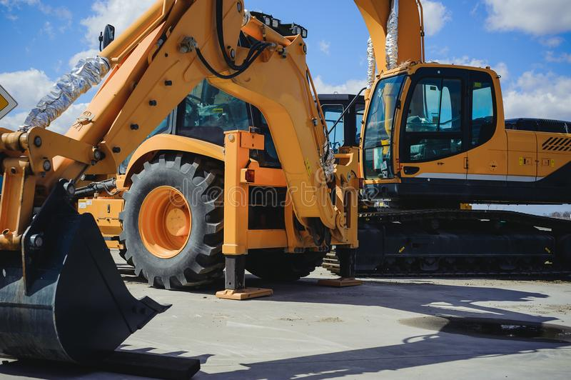 Road-building machinery, tractors yellow excavators in open air in working position royalty free stock photo
