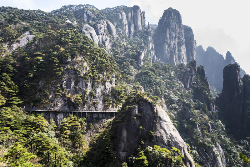 A road built along the face of a cliff royalty free stock photo