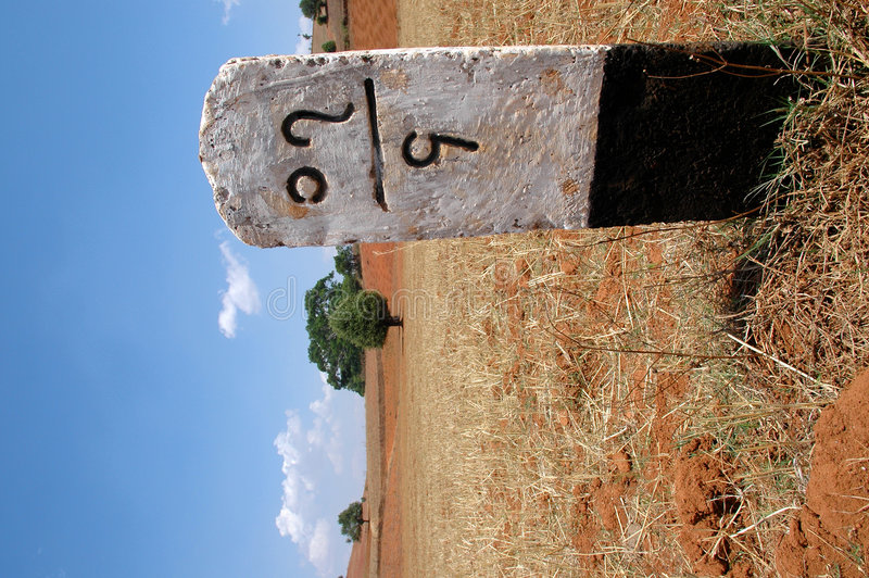 On he road in Burma. A distance post along the side of a rural road in Burma (Myanmar royalty free stock images