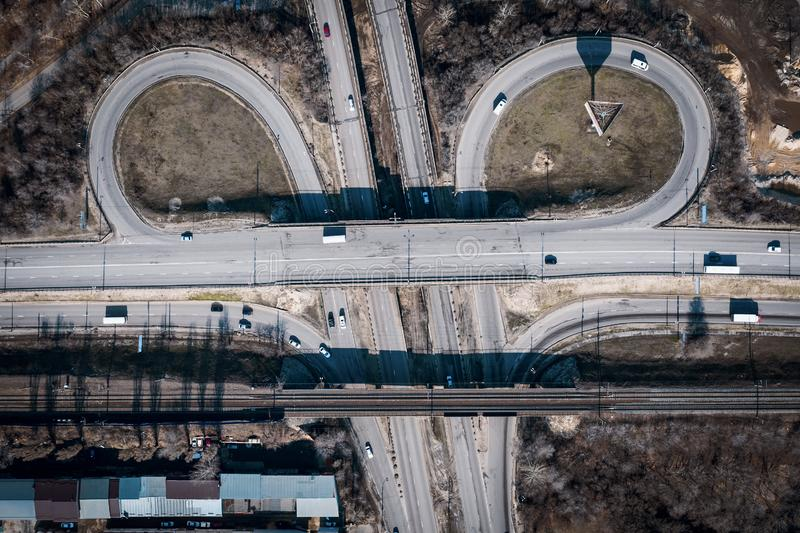 Road car traffic on crossroad or intersection or transport junction with circle movement, aerial top view. Toned stock image