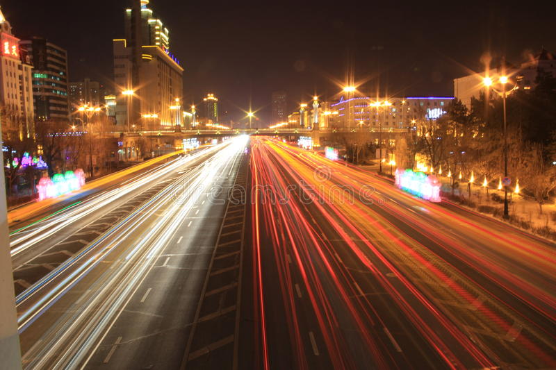 Road with car traffic at night with blurry lights. Traffic at night and blurry lights that showing speed stock photos