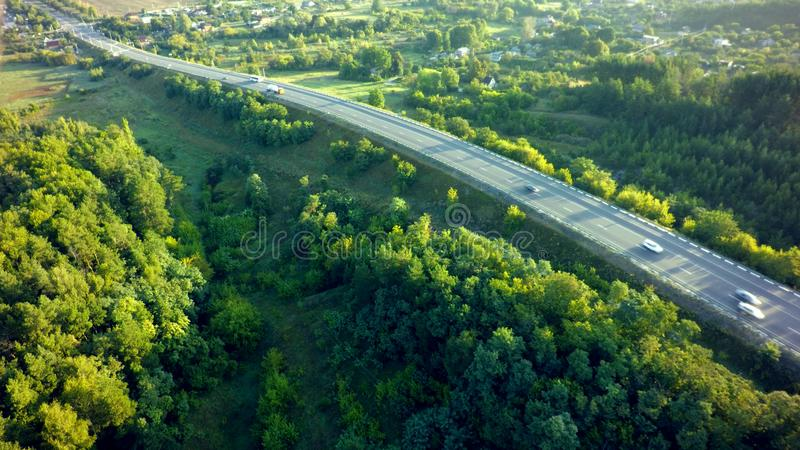 Road for cars aerial view from top around green nature.  stock photography