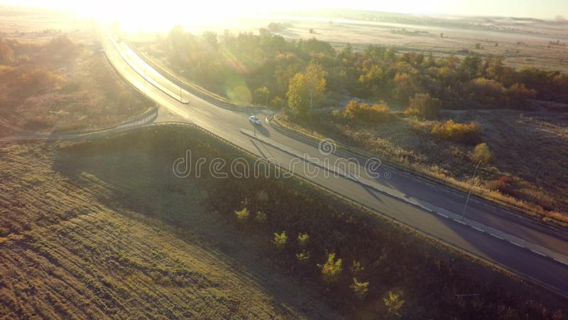 Road for cars aerial view from top around green nature.  royalty free stock photography
