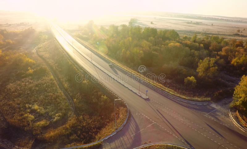 Road for cars aerial view from top around green nature.  stock image