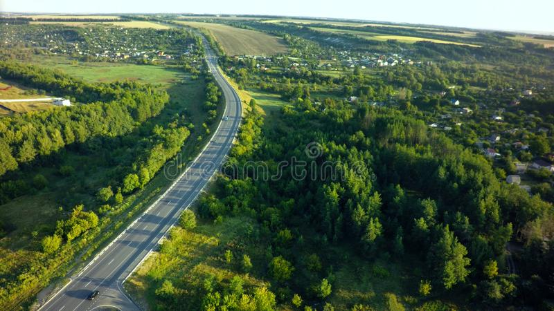 Road for cars aerial view from top around green nature.  royalty free stock photo