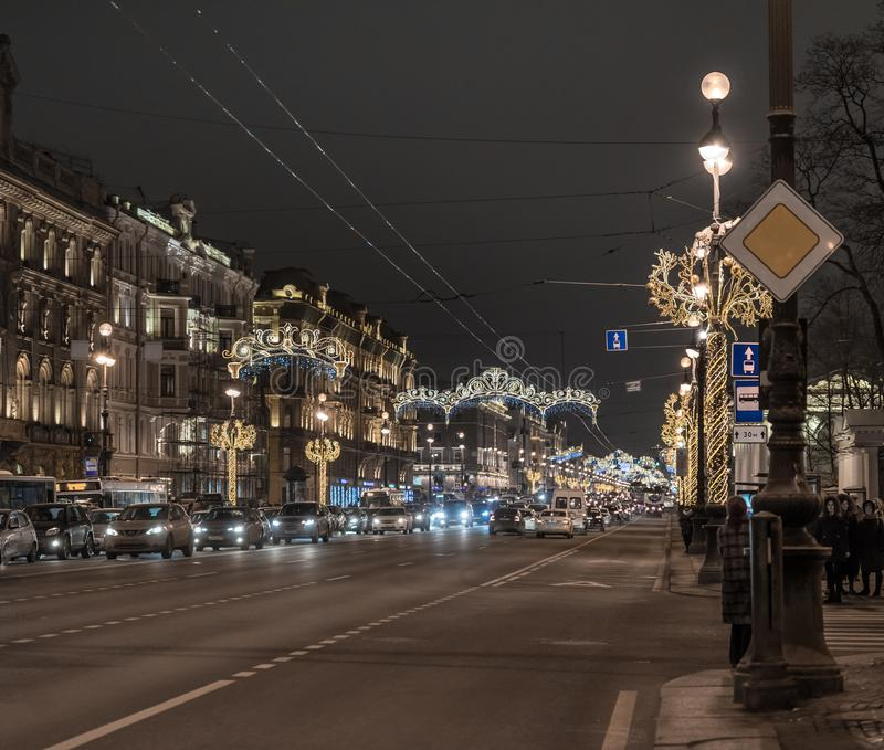 Night city Saint-Petersburg road illumination cars historical building. Road cars night city Saint-Petersburg lights illumination royalty free stock images
