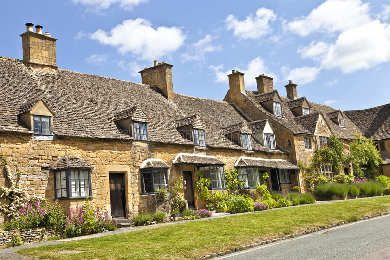 Road of charming village cottages with summer gardens royalty free stock image
