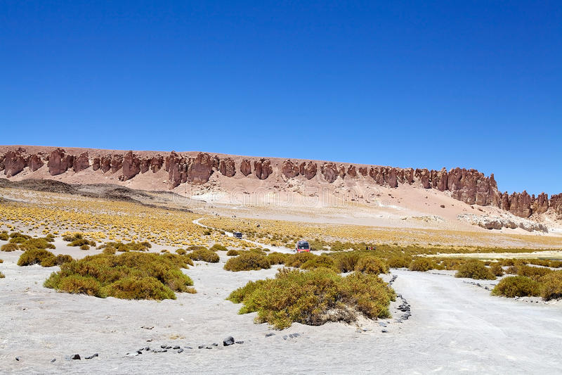 Road close to Salar the Tara, Chile. Vehicles ans tourists along the road close to Salar the Tara in the Los Flamencos National Reserve, Chile. It is an royalty free stock images