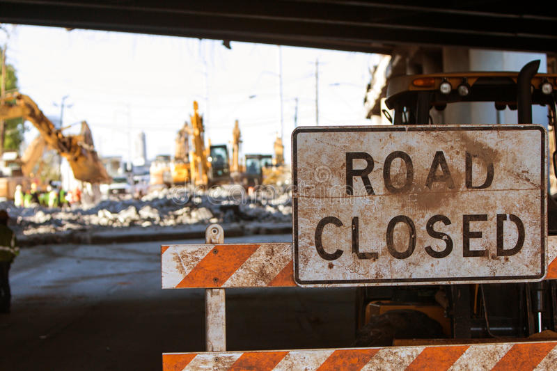 Road Closed Barricade Blocks Access To Major Interstate Construction. Worn Road Closed barricade blocks road at Atlanta collapsed interstate bridge construction royalty free stock photos