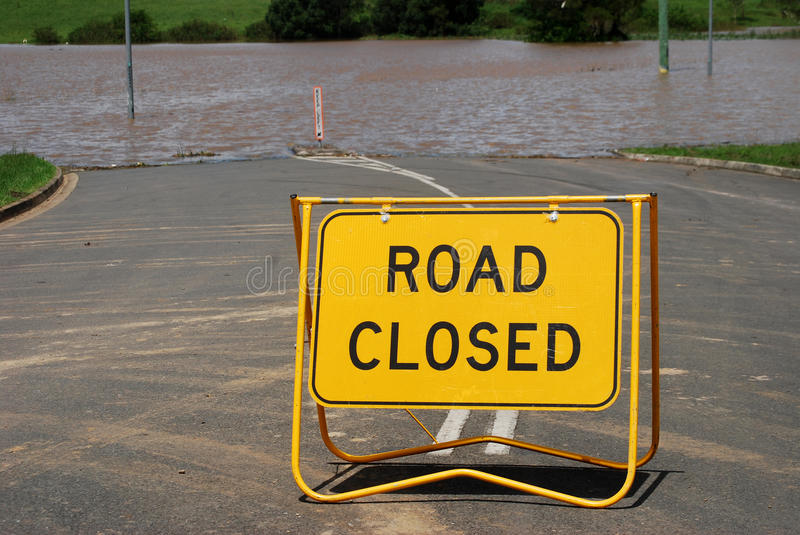 Road Closed sign over flooded road. Logan city has road closures all over the area due to the recent flooding this month as a result of the cyclone in north stock images