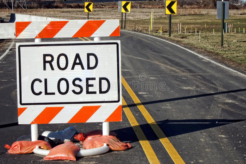 Road Closed Traffic Sign at Improvement Work Site. Road closed traffic warning safety sign on a small country road at a highway improvement work and construction royalty free stock photos