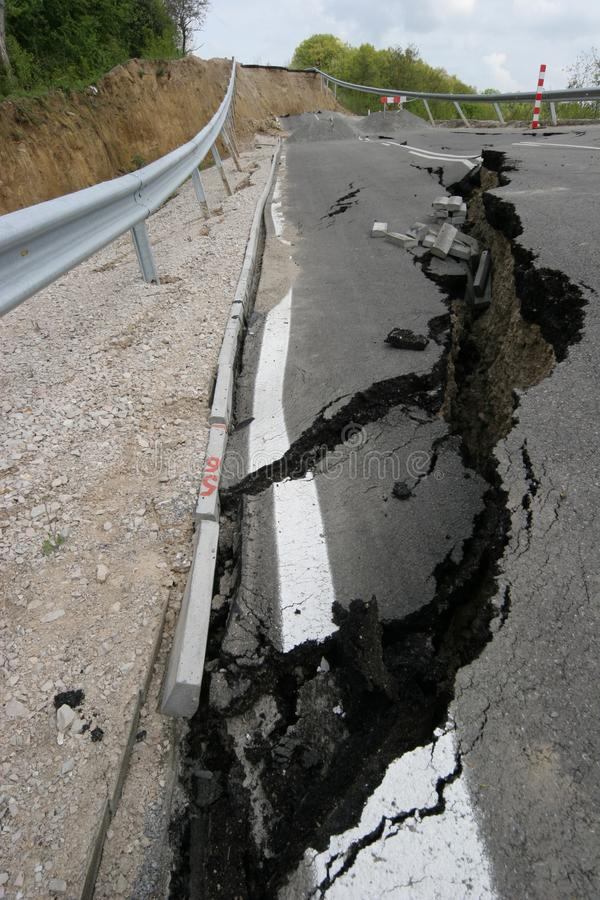 Road collapses with huge cracks. International road collapsed down after bad construction. Damaged Highway Road. Asphalt road. stock photography