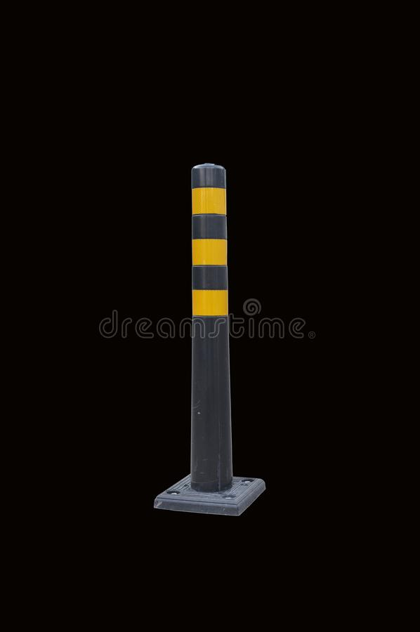 Road column, restriction of movement. Isolate black background stock photography