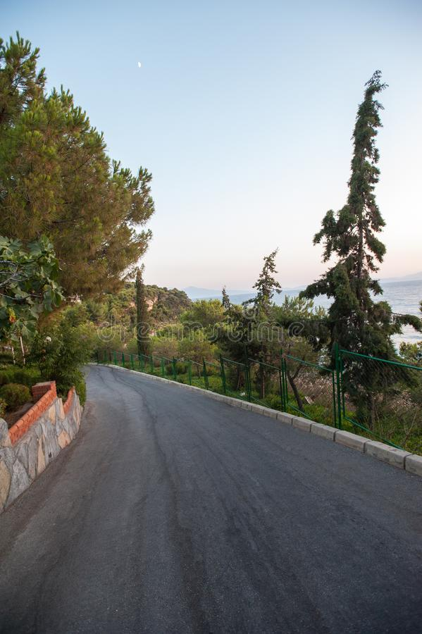 The road comes down from the mountain to the sea stock image