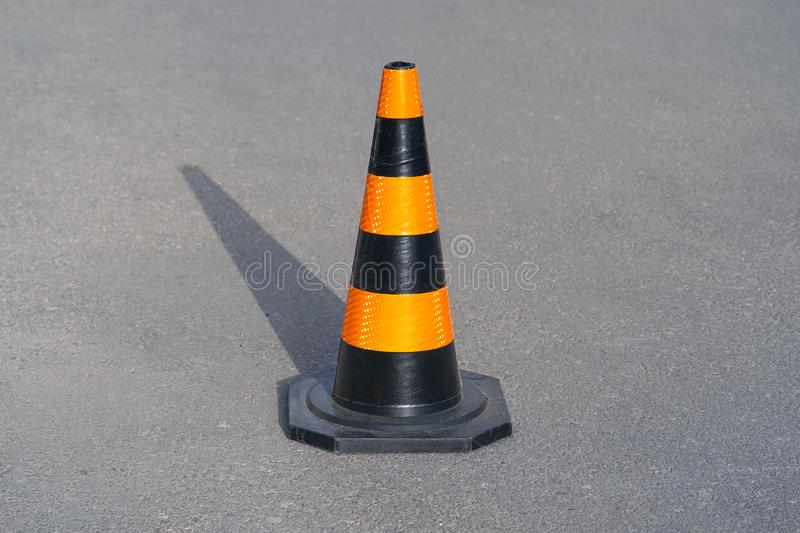 Road cone on the asphalt. Red caps on the road royalty free stock photos