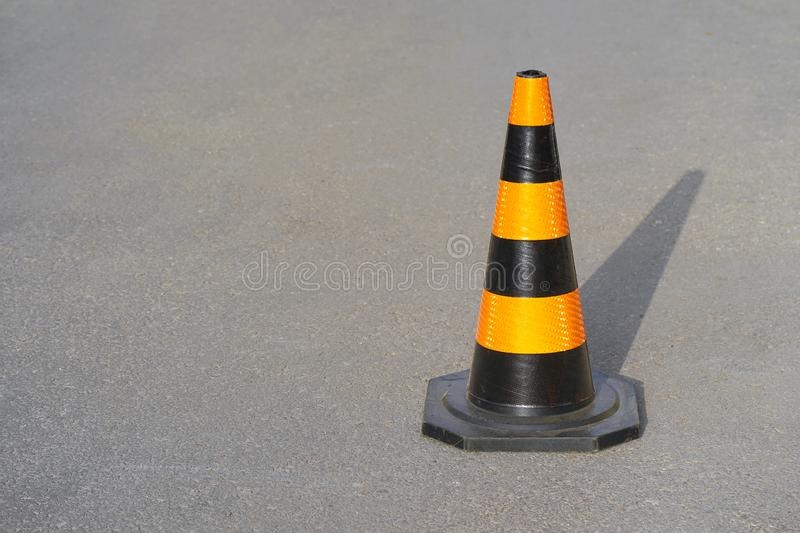 Road cone on the asphalt. Red caps on the road stock image
