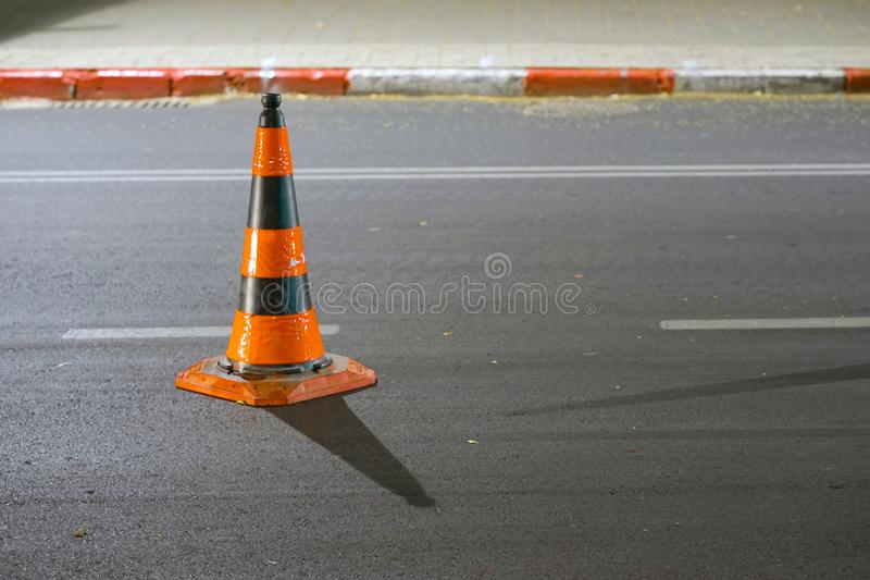 Road cone on the asphalt. Red caps on the road stock images