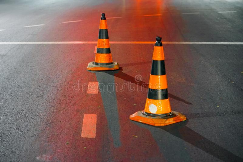 Road cone on the asphalt. Red caps on the road stock photography