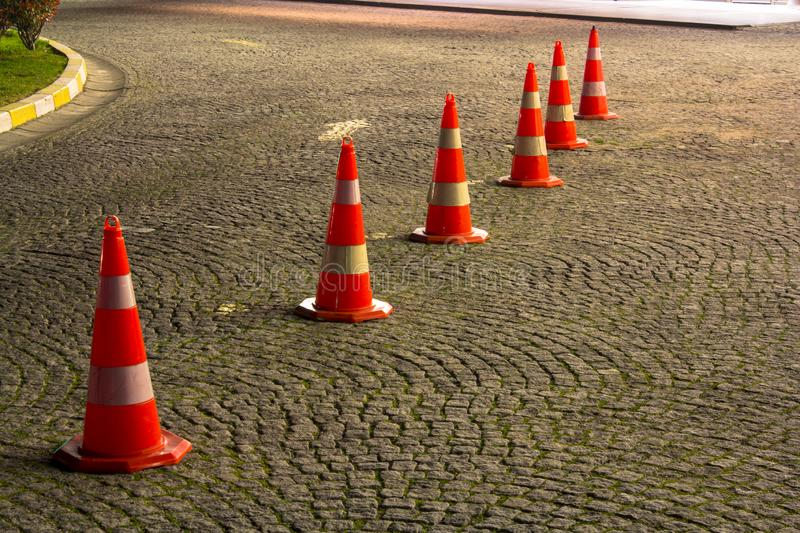Road cones on the pavement before entering somewhere royalty free stock image