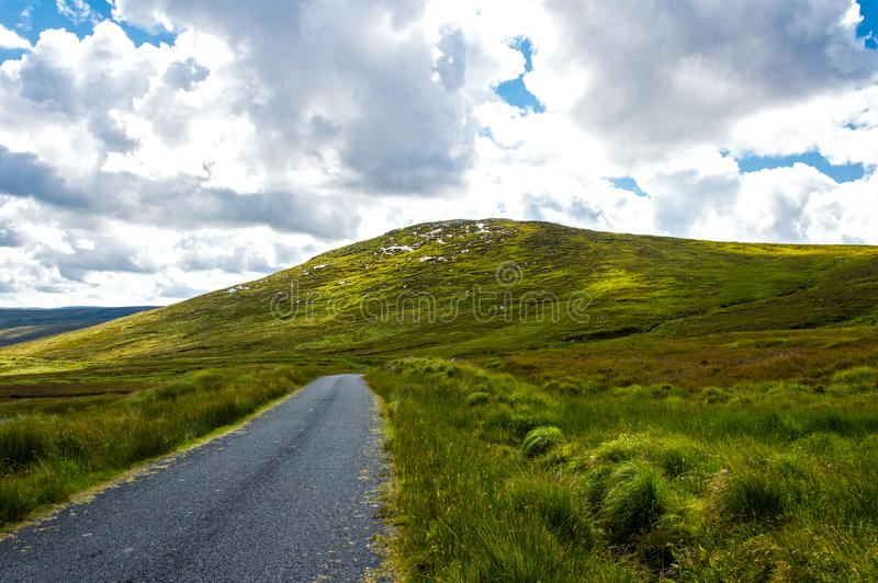 Road on Connemara mountains. Connemara is a district in the west of Ireland of which the boundaries are not well defined royalty free stock photography
