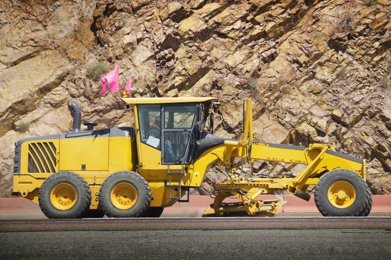 Road construction. Stock image of motor grader working on road construction stock images