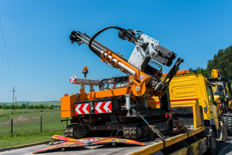 Road construction machinery, street signs on the truck. Odorheiu Secuiesc, Romania- 16 June 2019: Road construction machinery, street signs on the truck stock photography