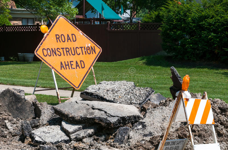 Road Construction sign. On the ground stock photos