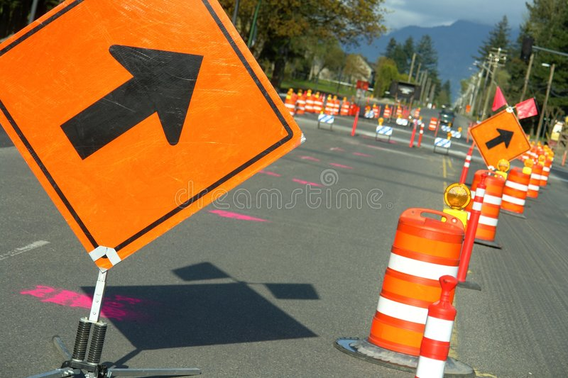 Road Construction Signs Arrow. Detour signs on a local road under construction royalty free stock photography