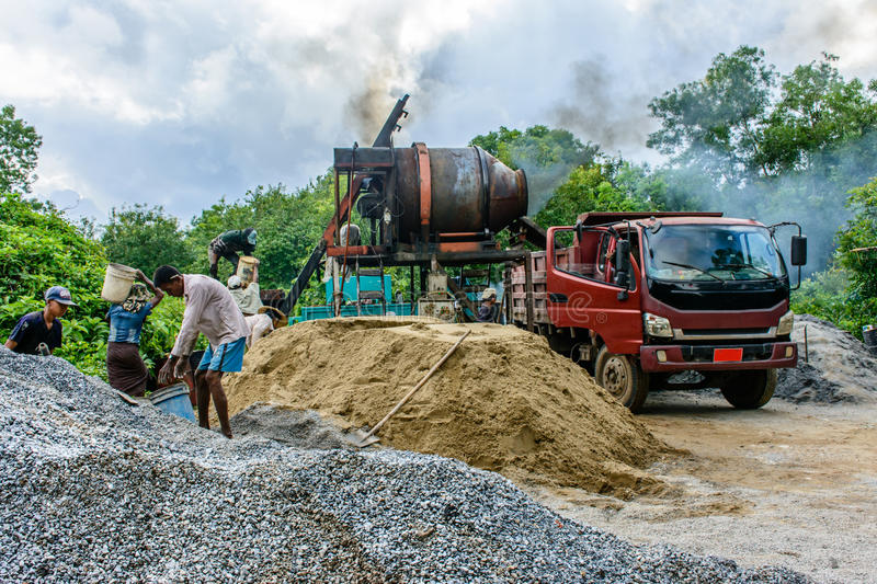 People do their work in road construction site, countryside of Myanmar, June-2017 royalty free stock photos