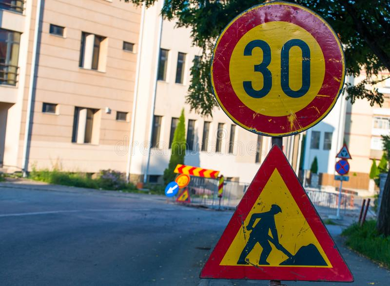 Road construction street signs close up shot. On the city street royalty free stock image