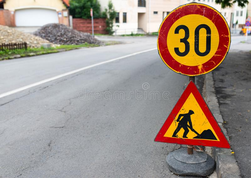 Road construction street signs close up shot. On the city streets stock images