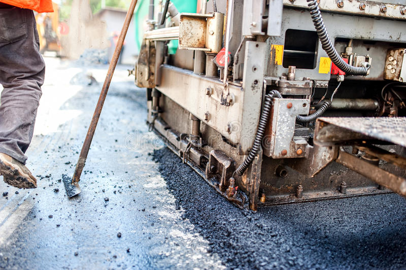 Road construction with tools, workers and industrial machinery royalty free stock photo