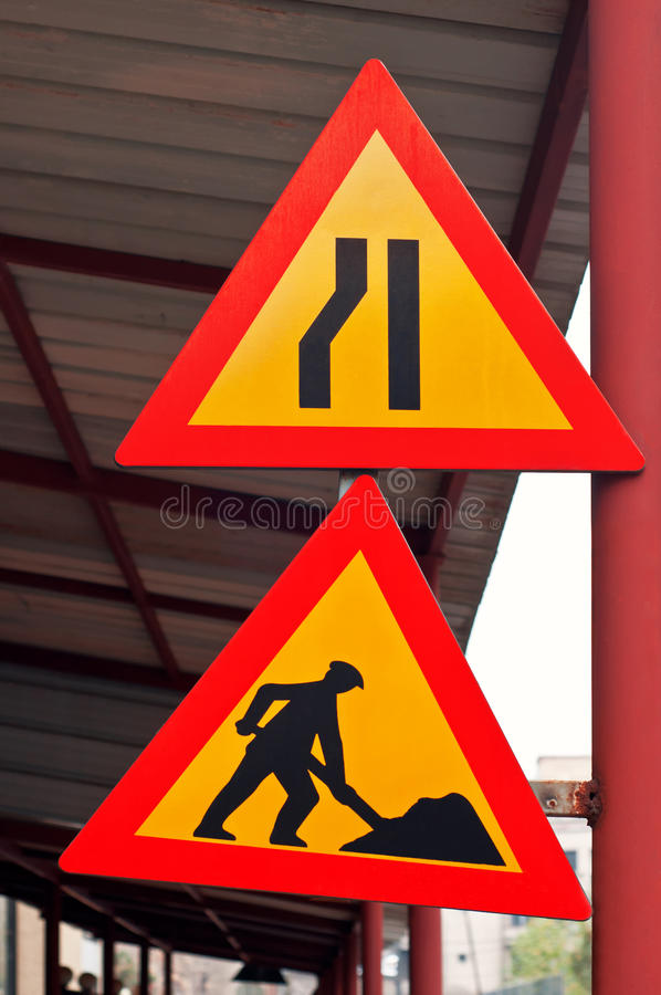 Road construction traffic signs. Under construction and constriction traffic signs isolated royalty free stock image