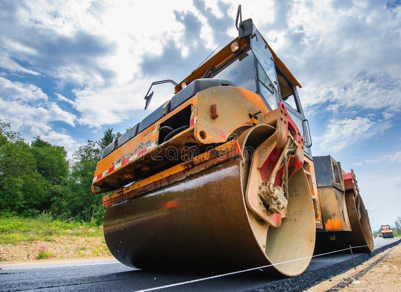 Road construction vehicle. New road construction paving asphalt repair vehicle royalty free stock photos