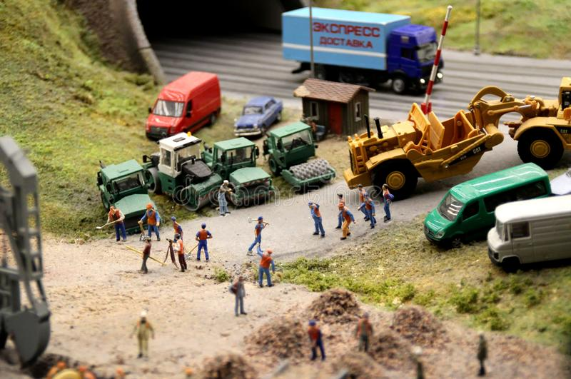 Road construction work macro shooting. Collective image of cities and regions of the Russian Federation, made in miniature. National show-museum `Grand layout stock image