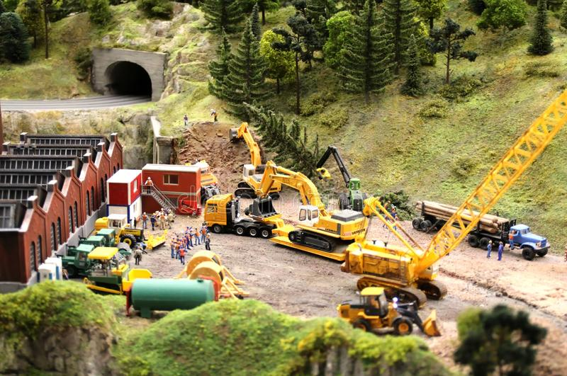 Road construction work. macro shooting. Collective image of cities and regions of the Russian Federation, made in miniature. National show-museum `Grand layout stock image