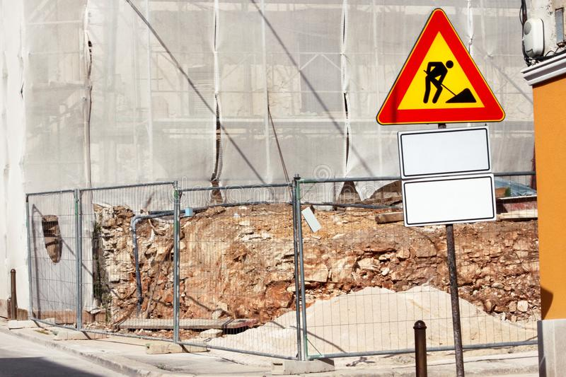 Road construction work and sign at a construction site. Warning sign under construction. royalty free stock photos