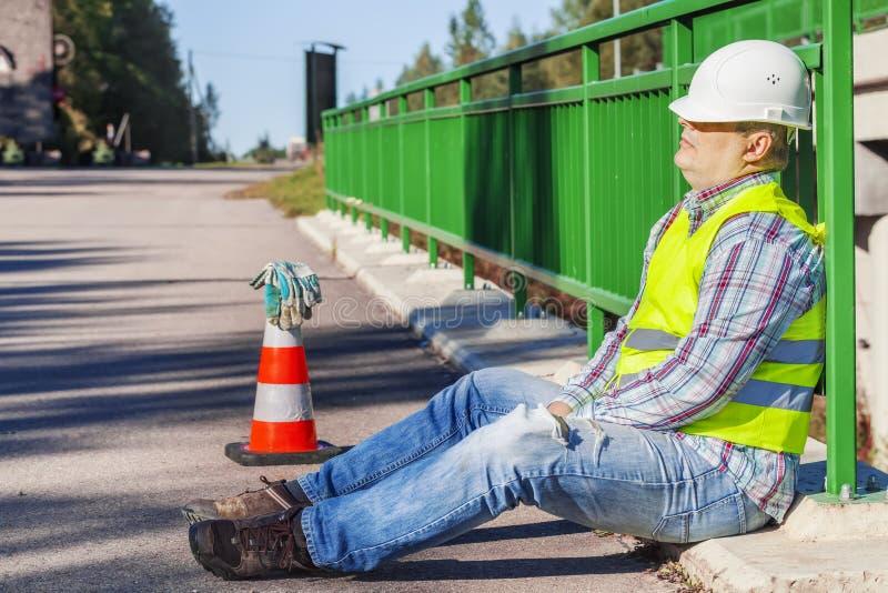 Road construction worker sleep on the bridge royalty free stock photos