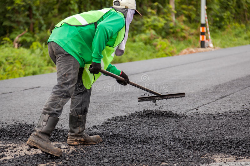 Road construction. Works with roller compactor machine and asphalt finisher stock photography