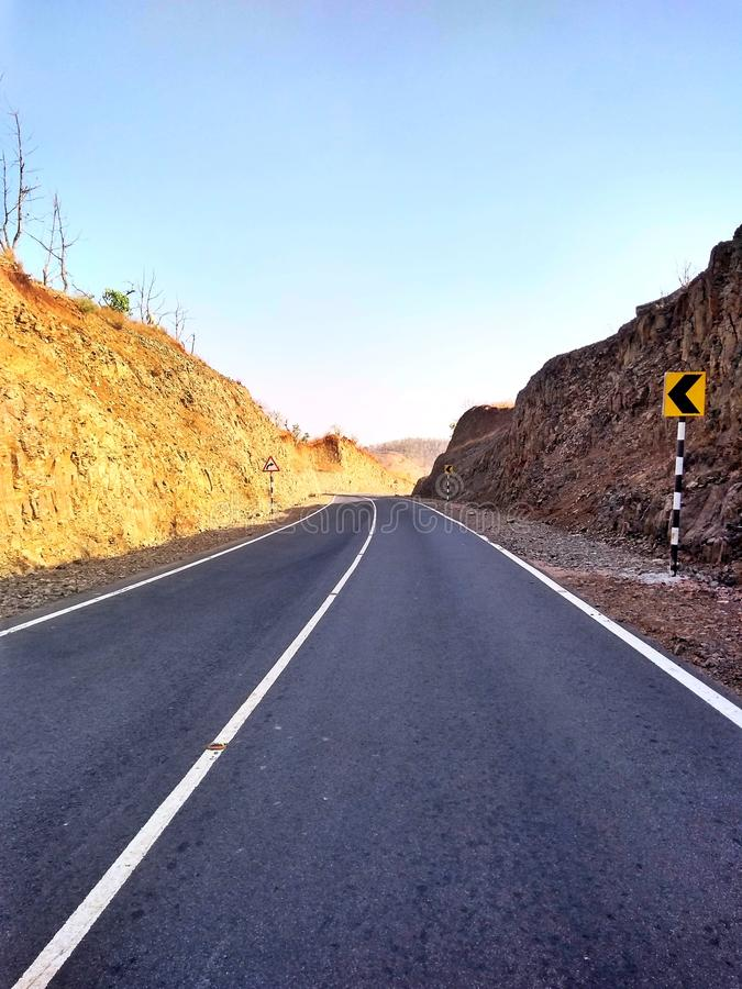 A road cover by rocks gives beautiful look stock photography