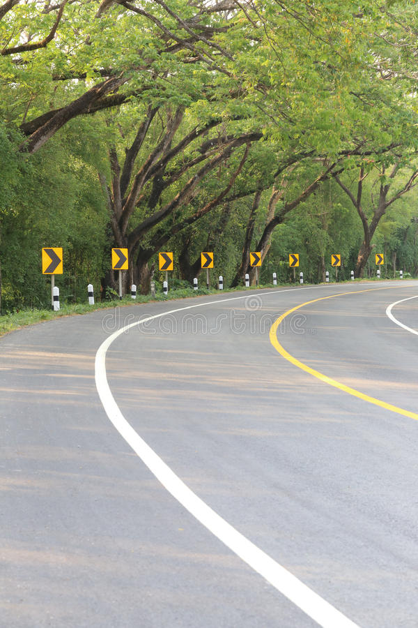The road curve with street signs reflex light. royalty free stock photography