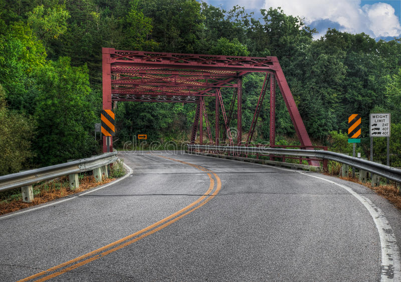 Road Curves Through Bridge