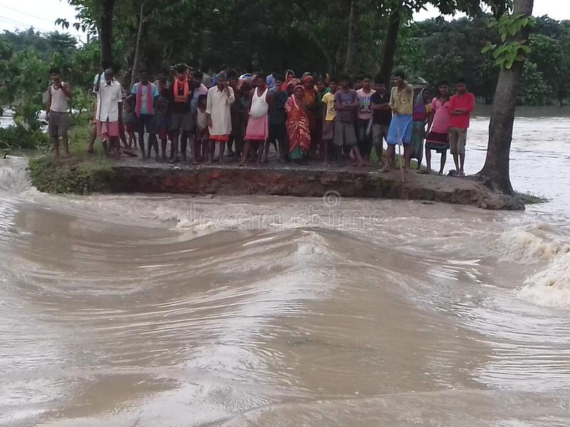 Road cutting in flood. Heavy monsoon rain brings flood in bihar India. This scene captured in forbesganj, a north-east bihar area. communication has break down royalty free stock photography