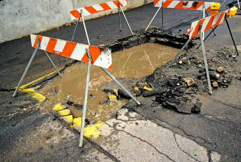 Road Damage. From water main break, Schenectady New York stock image