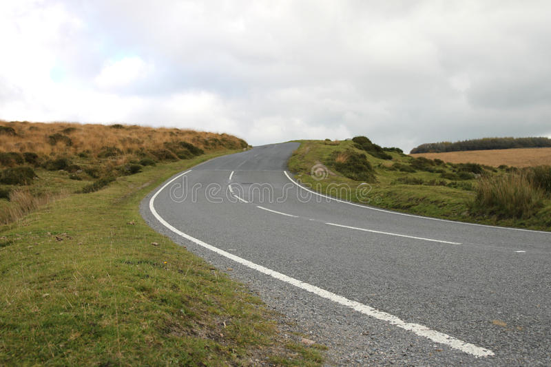 A road on Dartmoor, Devon in England. A road on Dartmoor in Devon, England. Twisting up a hill royalty free stock images