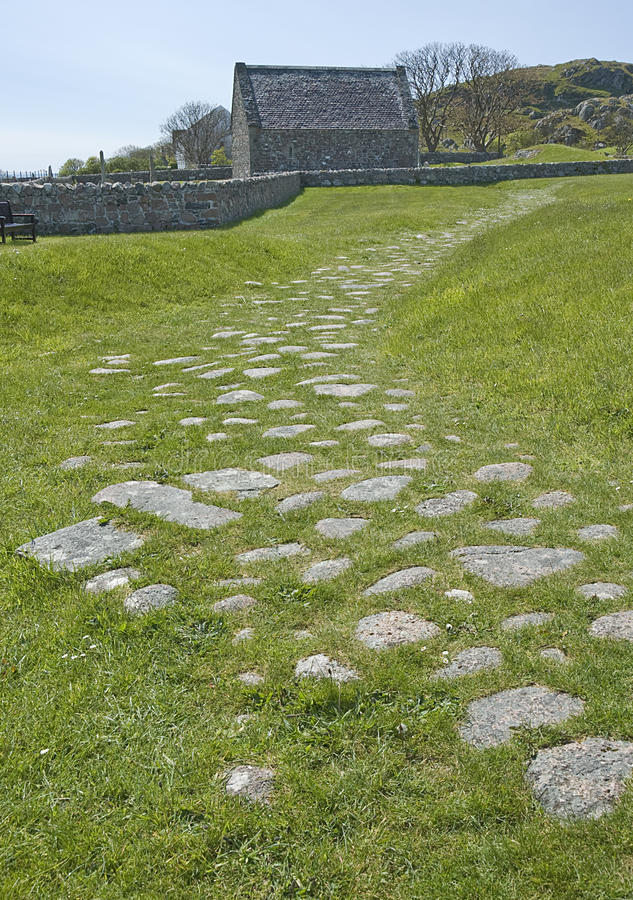 Road of the Dead. Remains of a medieval, cobbled road on the island of Iona, Argyll, Scotland, beside Reilig Ã'dhrain, the burial ground surrounding the royalty free stock images