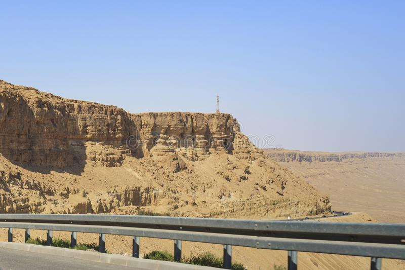 Road descent to Ramon earth crater, Israel royalty free stock images